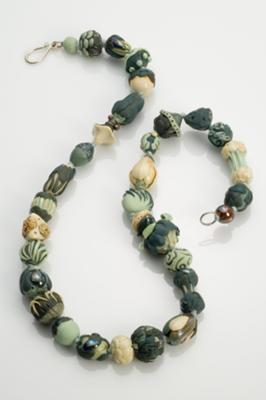 Hand-formed beads strung on silk, hand-formed sterling clasp